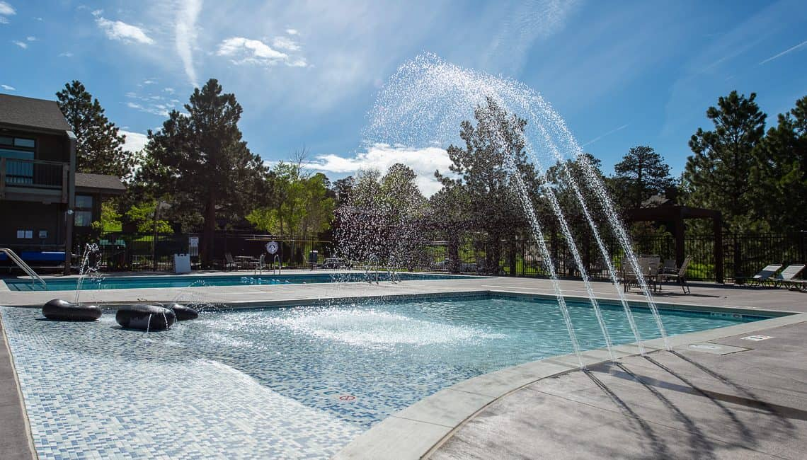 Kiddie pool with pop jets and zero depth entry at the Vista Clubhouse in Genesee done by Colorado Hardscapes.