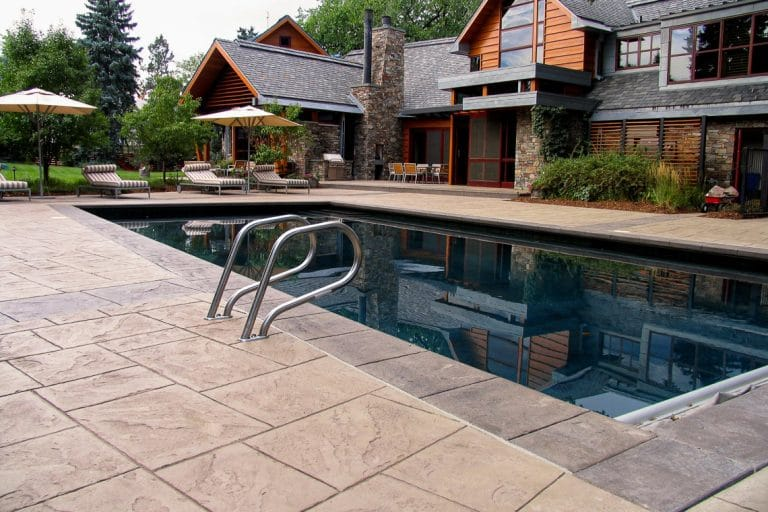 Residential pool deck with imprinted finish.