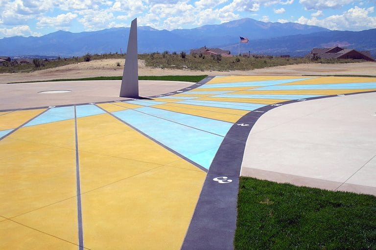 Large school play space with sun dial Microtop - ST Concrete Overlay - Colorado Hardscapes