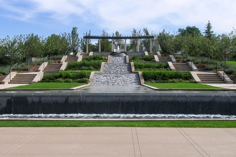 Architectural, ascending water feature with stairs on each side.
