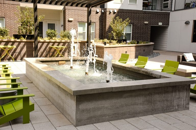 Board form water feature in apartment courtyard