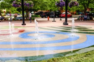 A muliticolored splash pad Microtop - ST Concrete Overlay - Colorado Hardscapes