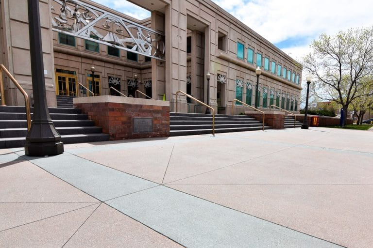 Sandscape finish at entrance of justice center Decorative Sawcuts on Flatwork - Colorado Hardscapes