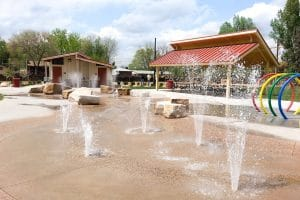 Interactive pop jets and splash pad