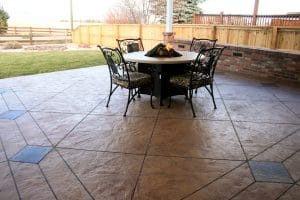 Back patio with Bomanite imprinted concrete and colored diamond sections