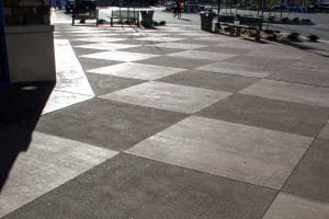 Broom finish on uncolored concrete at plaza