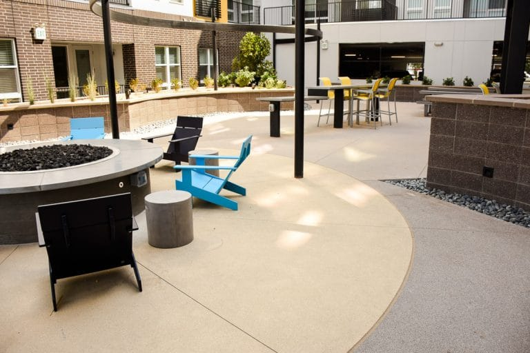 Sandscape® refined flatwork next to fire pit
