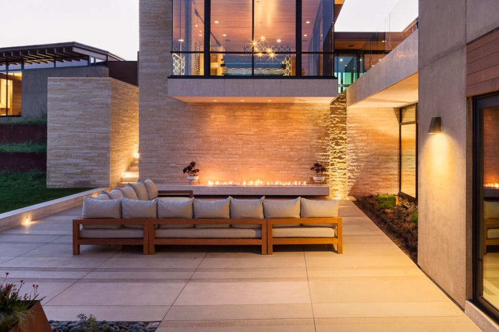 Back porch with couch seating on integral color banding and Sandscape® refined details