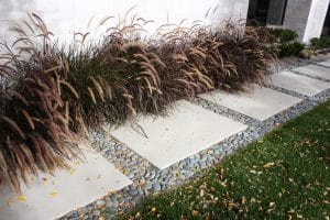 Sandscape® Refined concrete panels bordering yard