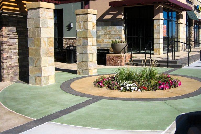 Color hardener surrounding flower bed at shopping center.