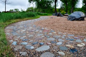 Close up of large exposed aggregates embedded into outdoor path