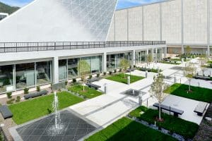 Courtyard with white integral color on walkways showcasing decorative concrete.