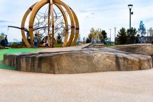 Shotcrete rocks next to play area at outlets.