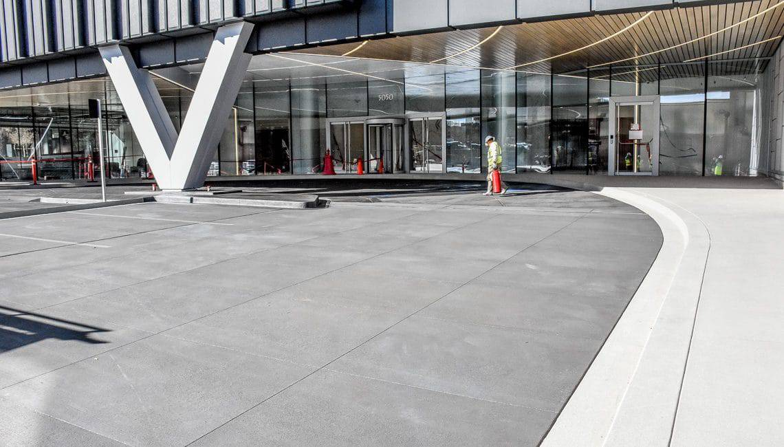 Office building in DTC with sanscape refined and broom finished concrete