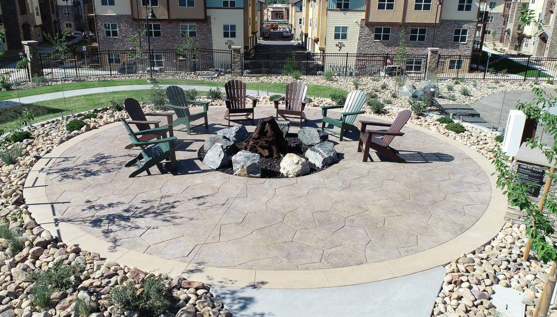 Bomanite imprinted flatwork around fire pit at Vantage Point Apartments.