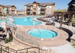 Distant perspective of Bomanite imprinted pool deck at Vantage Point Apartments.
