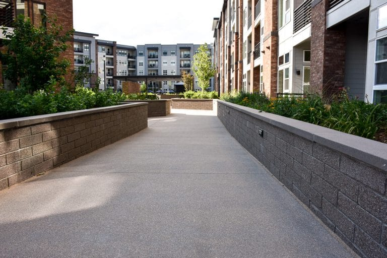 A Sandscape walkway leading down to courtyard