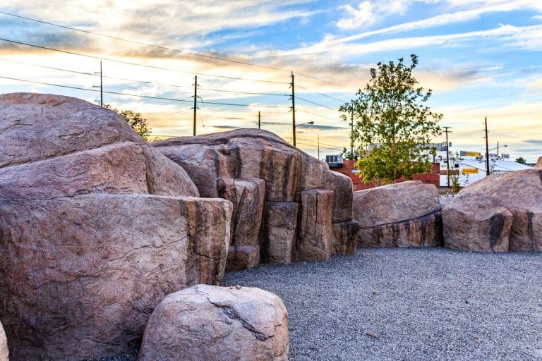 large concrete boulders create a play space in the park