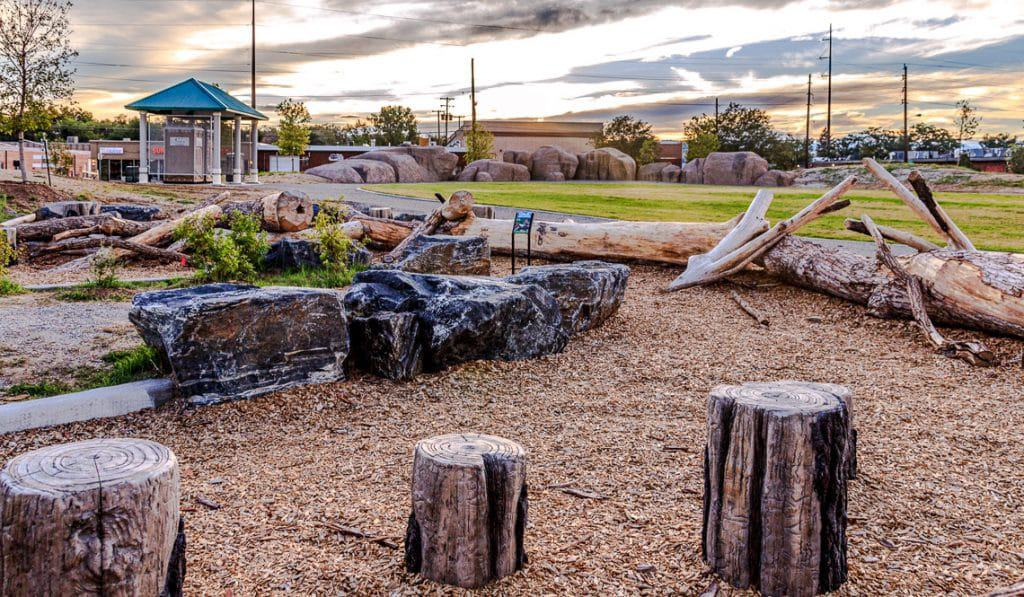 vertical concrete stumps nested with natural drift wood.