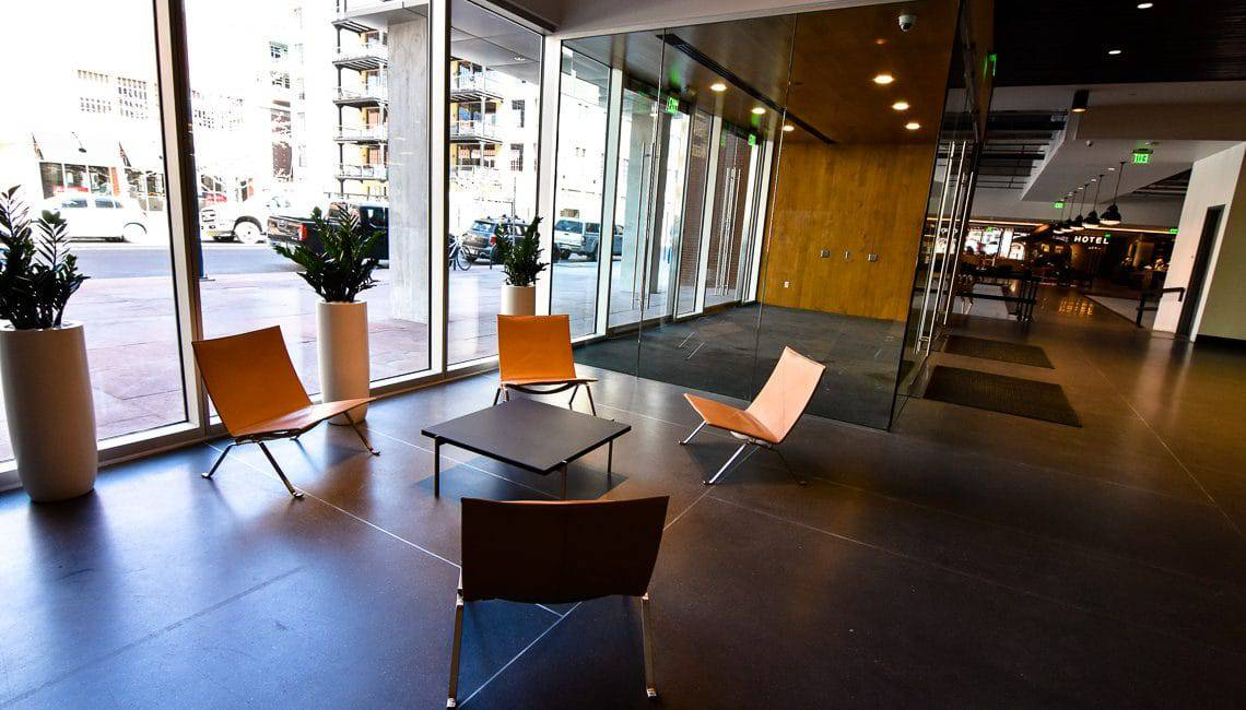 Cement-based terrazzo flooring in office lobby