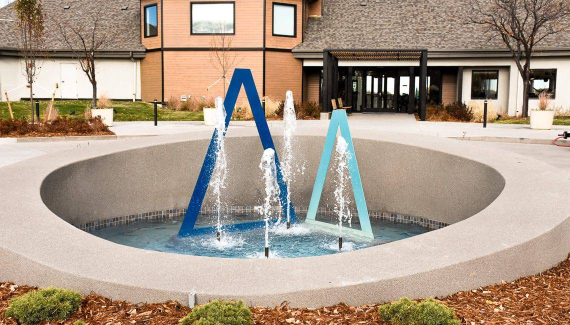 Water feature with sandscape wall basin.