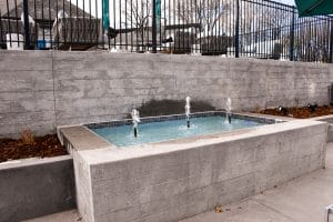 Board form walls were used on the front and sides of this water feature basin.