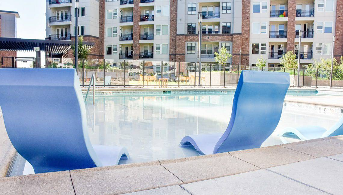 Apartment complex pool with quality Sandscape coping