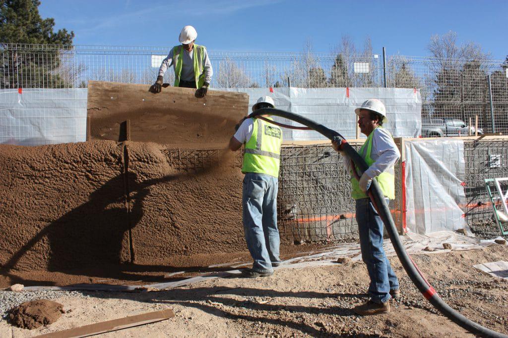 Shotcrete installing the concrete wall