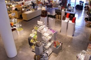 Uncolored, smooth troweled concrete in mall retail store