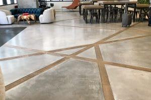 Uncolored, smooth troweled, concrete floors have wood cross-sections