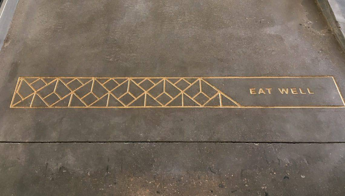 """CNC engraved design saying """"EAT WELL"""""""