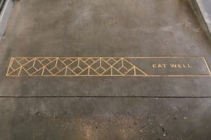"CNC engraved design saying ""EAT WELL"""