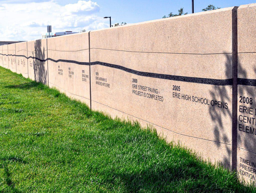 Elementary school wall incorporating sandblasting designs.