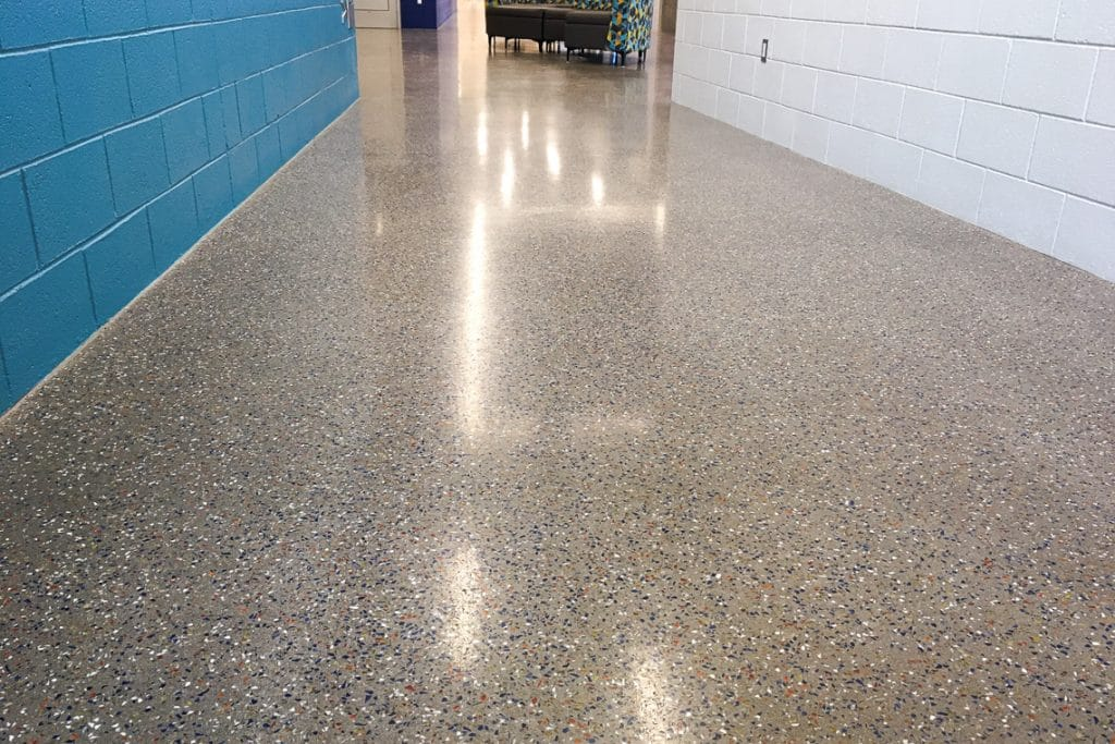 high-end cement-based terrazzo material flooring option for interior overlays provided by Colorado Hardscapes at Aurora Rec Center