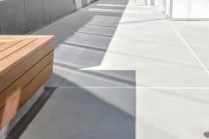 Condominium balcony with sandscape refined walkway.