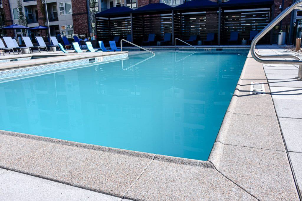 Up close apartment complex pool with quality Sandscape coping