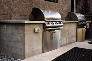 Apartment courtyard BBQ grill area with a board form walls