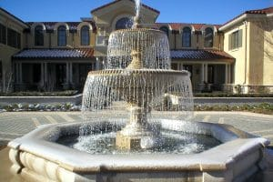 Three tier, architectural water feature in front of private residence
