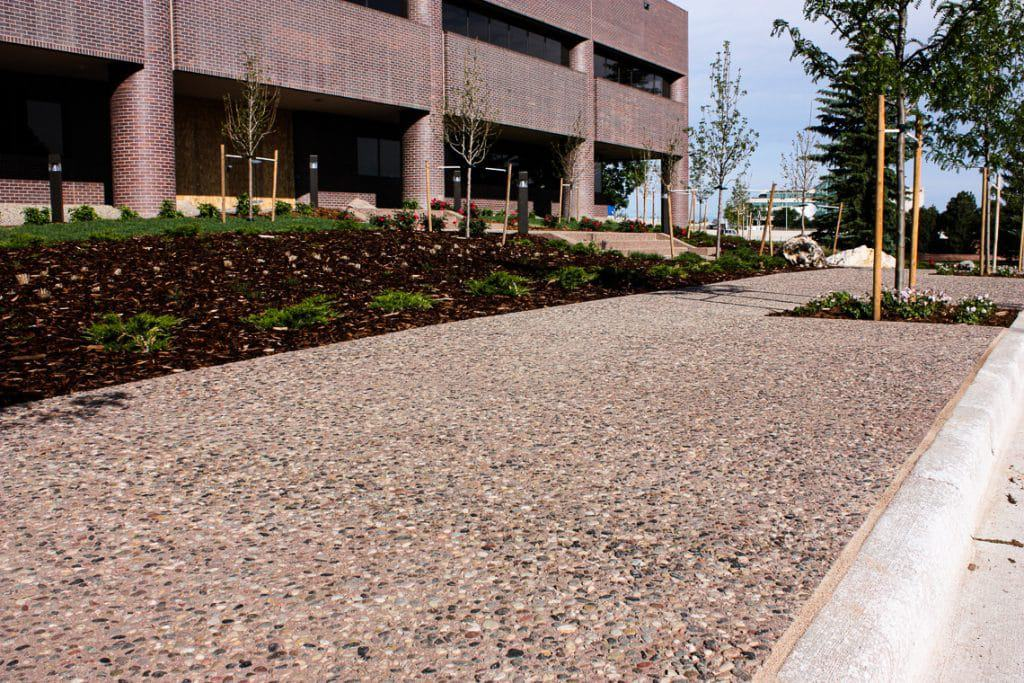 Exposed aggregate flatwork done on exterior pathway at office building.