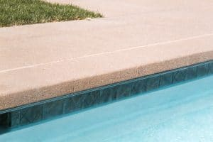Pool coping and deck done with sandscape