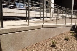 This wheelchair ramp Microtop - ST Concrete Overlay - Colorado Hardscapes