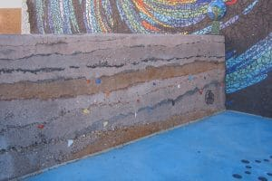 Sedimentary wall has aggregate within wall