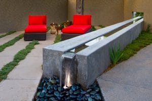 Form finish wall and water feature at private residence