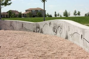 Pictures and designs on short concrete wall