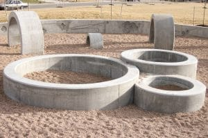 Concrete rings in playground finished with form finish method