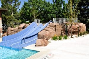 Pool slide attached to GFRC rockwork