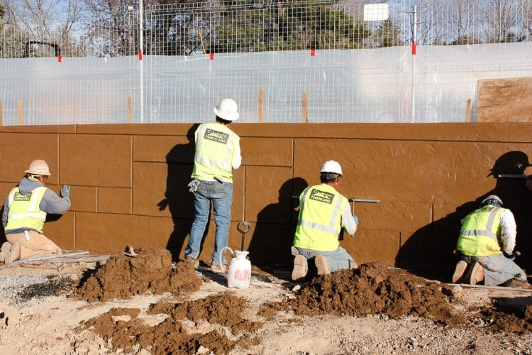 This picture shows the team hard at work getting the shotcrete wall in place.