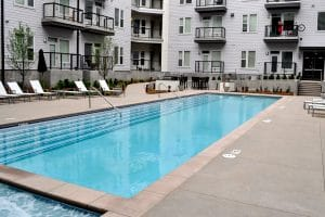 Sandscape® pool deck in apartment courtyard
