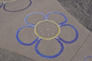 Flower design integrated into Sandscape® concrete