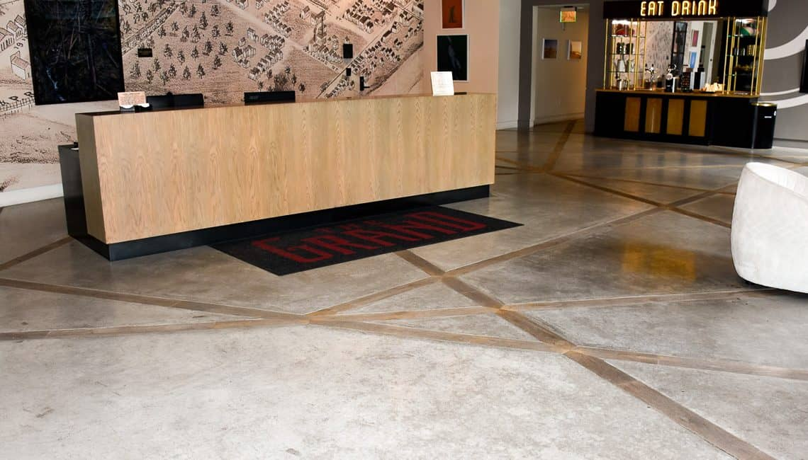 Troweled floor with wood planks embedded within.